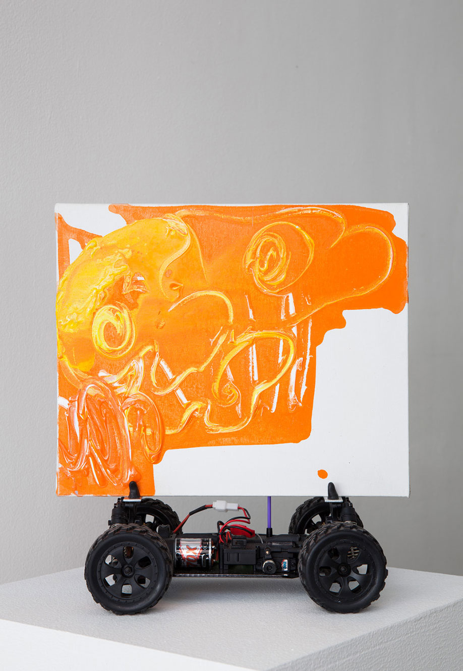<b>Title:&nbsp;</b>Remote Control Painting<br /><b>Year:&nbsp;</b>2013<br /><b>Medium:&nbsp;</b>Remote control car, painting<br /><b>Size:&nbsp;</b>34 x 30 x 19 cm