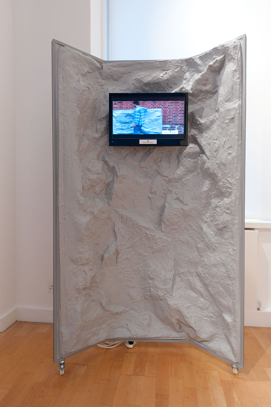 <b>Title:&nbsp;</b>Real Stone Effect <br /><b>Year:&nbsp;</b>2012<br /><b>Medium:&nbsp;</b>HD video, monitor, PVC, steel<br /><b>Size:&nbsp;</b>180 x 105 x 55 cm