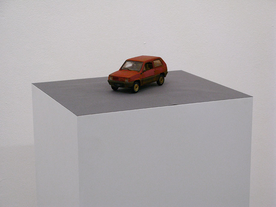 <b>Title:&nbsp;</b>Eventually I Will Rust And Die/Before I Go I Will Take Some Of You With Me (Fiat Panda)<br /><b>Year:&nbsp;</b>2009<br /><b>Medium:&nbsp;</b>Car, car sticker, plinth, car, adapted car model (1:24 scale), plastic, card<br /><b>Size:&nbsp;</b>Dimensions variable