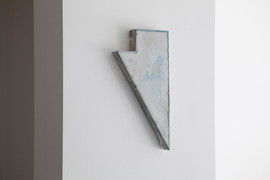 <b>Title:&nbsp;</b>Rising Triangle<br /><b>Year:&nbsp;</b>2014<br /><b>Medium:&nbsp;</b>Oil on board and linen, concrete wash, staples<br /><b>Size:&nbsp;</b>43 x 21 x 4 cm, Photo courtesy of Castlefield Gallery, Manchester