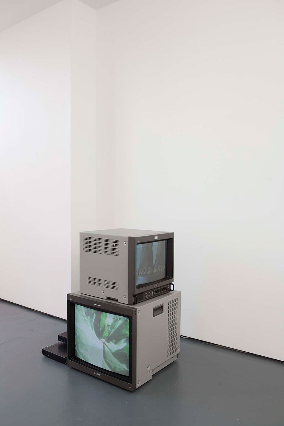 <b>Title:&nbsp;</b>Hold Me Tight And Let Me Go<br /><b>Year:&nbsp;</b>2013<br /><b>Medium:&nbsp;</b>Two channel video and box monitors<br /><b>Size:&nbsp;</b>Dimensions variable