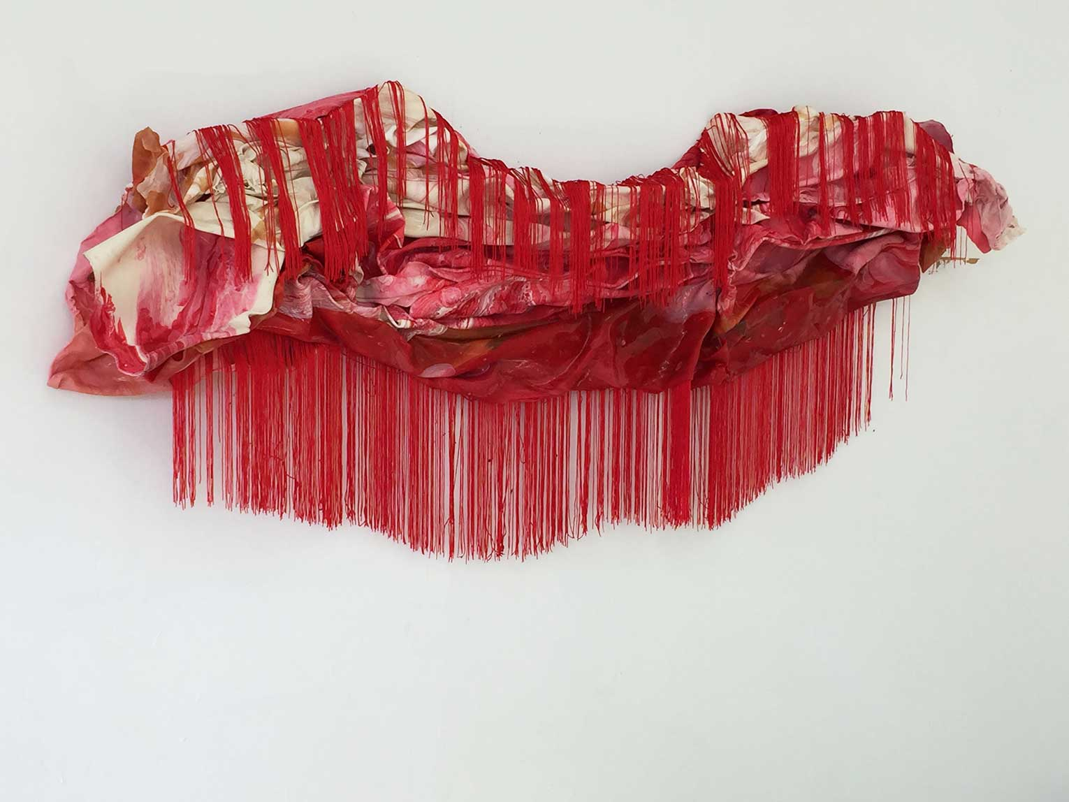 <b>Title:&nbsp;</b>Prolapse<br /><b>Year:&nbsp;</b>2018<br /><b>Medium:&nbsp;</b>Marbled latex, polyester fringing<br /><b>Size:&nbsp;</b>240 x 40 cm