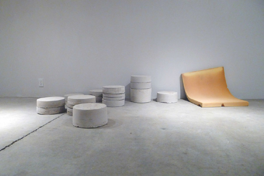 <b>Title: </b>Untitled (Casts and Cushion)<br /><b>Year: </b>2014<br /><b>Medium: </b>Cement casts of buckets and remnant sofa cushion<br /><b>Size: </b>Dimensions variable