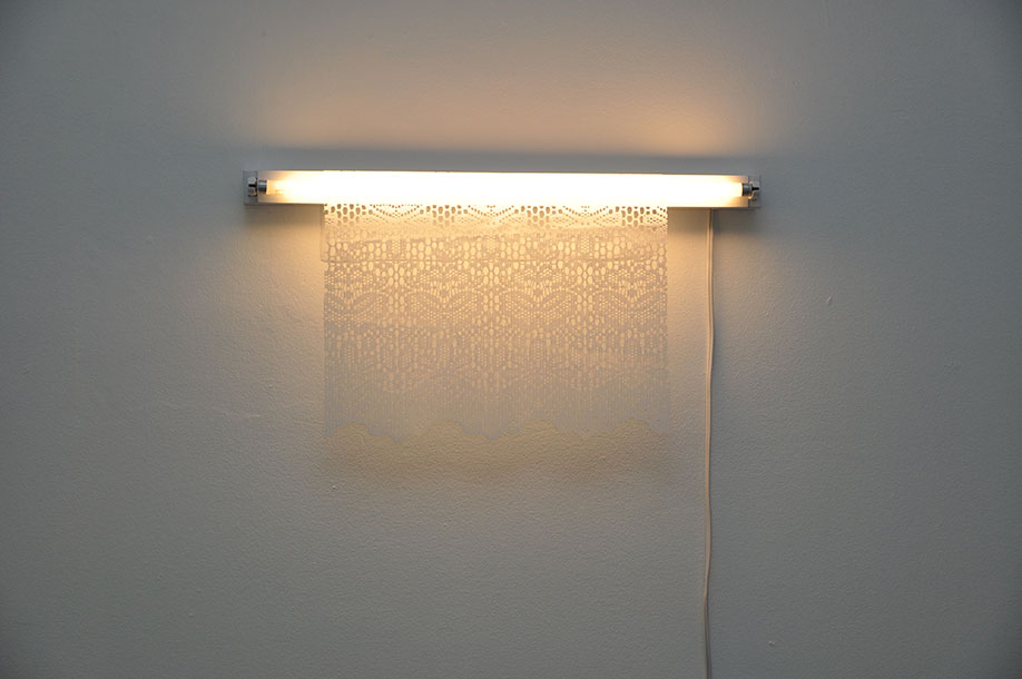 <b>Title: </b>Untitled (Lamp)<br /><b>Year: </b>2011<br /><b>Medium: </b>Fluorescent lamp and plastic lace<br /><b>Size: </b>Dimensions variable