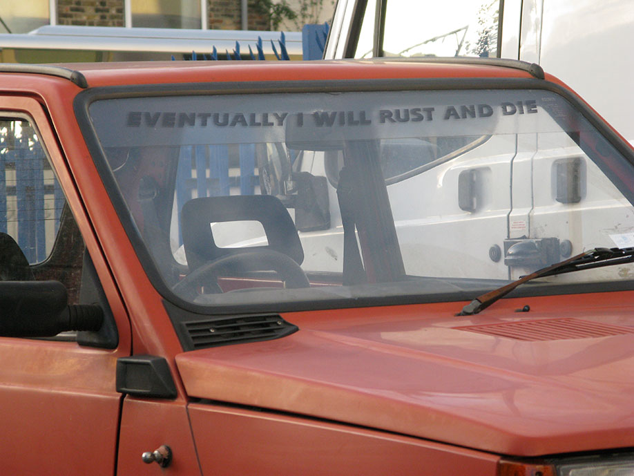 <b>Title: </b>Eventually I Will Rust And Die/Before I Go I Will Take Some Of You With Me (Fiat Panda)<br /><b>Year: </b>2009<br /><b>Medium: </b>Car, car sticker, plinth, car, adapted car model (1:24 scale), plastic, card<br /><b>Size: </b>Dimensions variable