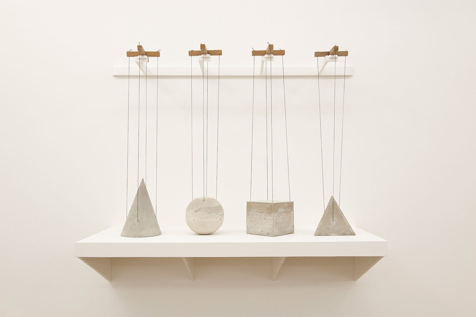 <b>Title: </b>Divining Rods<br /><b>Year: </b>2010<br /><b>Medium: </b>Concrete, string and wood<br /><b>Size: </b>85 x 122 x 46 cm