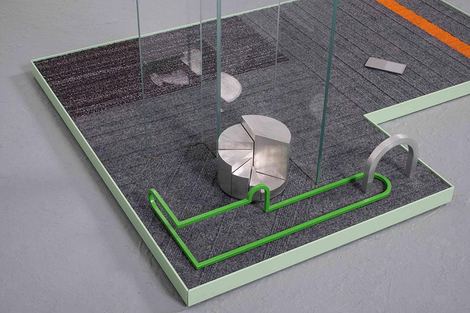 <b>Title:</b>Focus Group (detached, waiting)<br /><b>Year:</b>2015<br /><b>Medium:</b>Carpet, powder coated aluminium, machined aluminium, glass, vinyl, brass, MDF, and Perspex<br /><b>Size:</b>93 x 101 x 76 cm