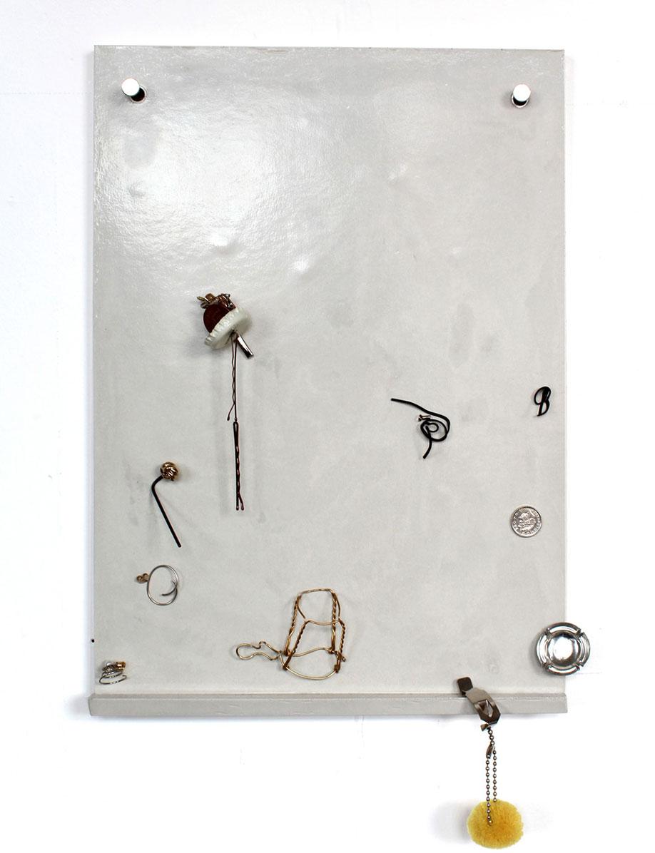 <b>Title:</b>Untitled (fridge door)<br /><b>Year:</b>2015<br /><b>Medium:</b>Magnets, assorted metal pieces, and Jesmonite<br /><b>Size:</b>39 x 27 x 2 cm