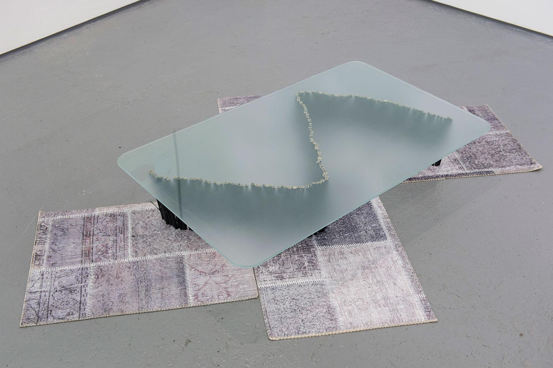 <b>Title:</b>Land Direct<br /><b>Year:</b>2016<br /><b>Medium:</b>Toughened glass, bamboo, and door mats<br /><b>Size:</b>19 x 180 x 120 cm