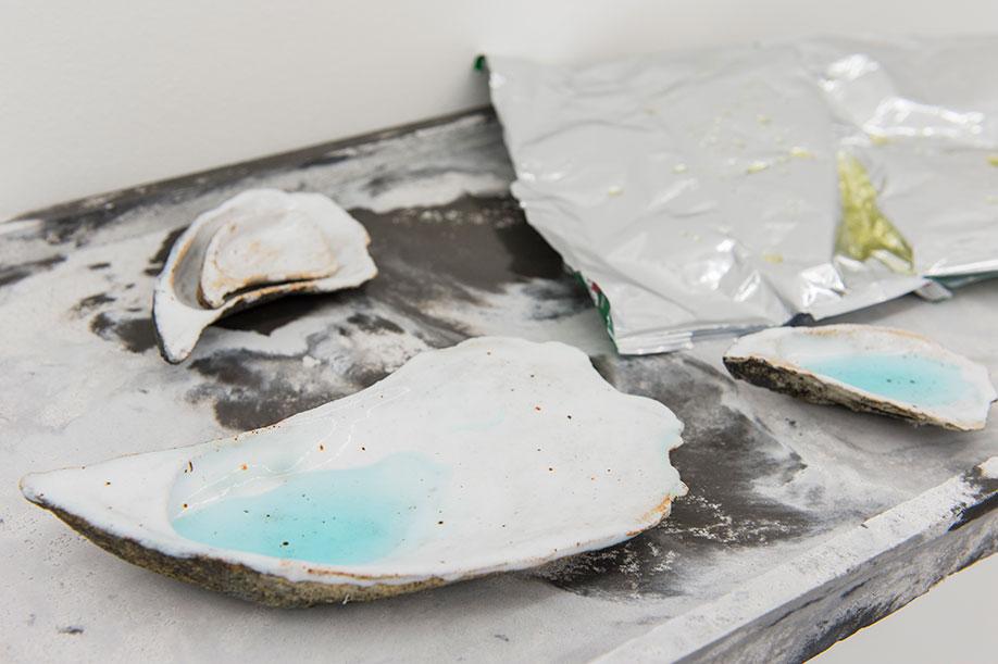 <b>Title:</b>Not Me But Me, detail<br /><b>Year:</b>2016<br /><b>Medium:</b>Ciment Fondu, liquid soap, glazed ceramic, crisp packet, and resin<br /><b>Size:</b>8 x 57 x 31 cm
