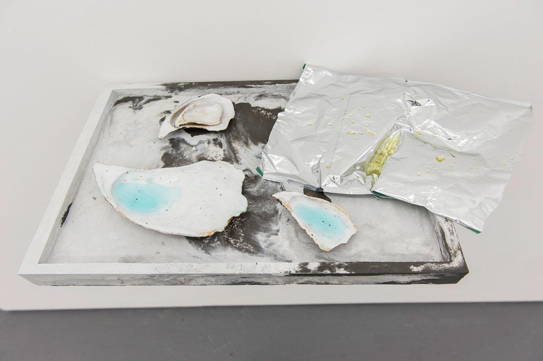 <b>Title:</b>Not Me But Me<br /><b>Year:</b>2016<br /><b>Medium:</b>Ciment Fondu, liquid soap, glazed ceramic, crisp packet, and resin<br /><b>Size:</b>8 x 57 x 31 cm