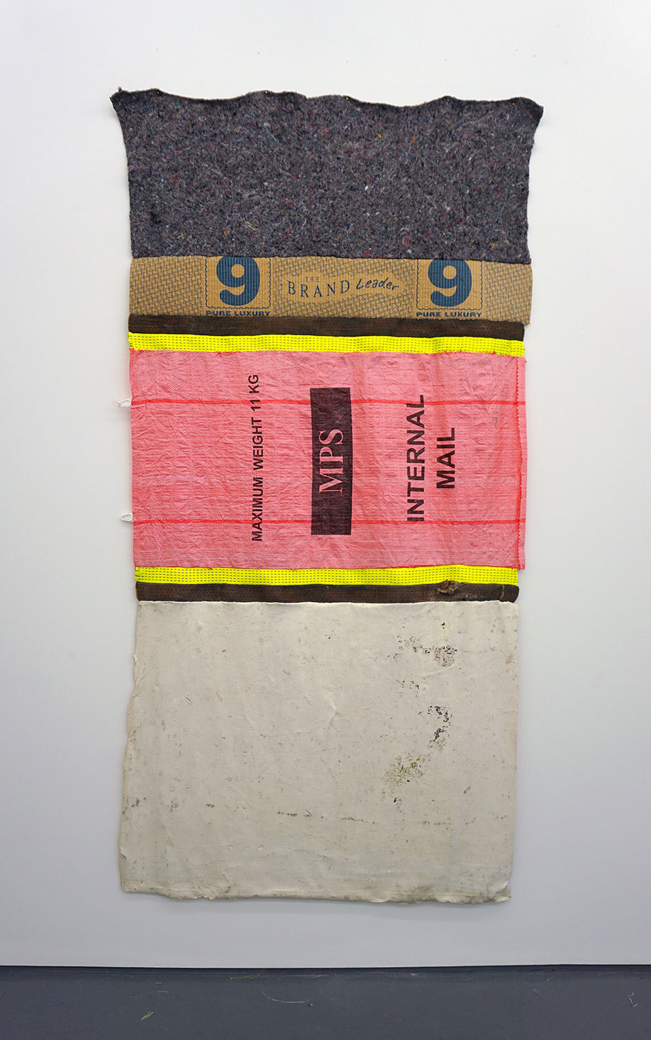 <b>Title: </b>Internal Mail<br /><b>Year: </b>2016<br /><b>Medium: </b>Latex, recycled plastic, recycled fibres, carpet underlay<br /><b>Size: </b>220 x 112 cm