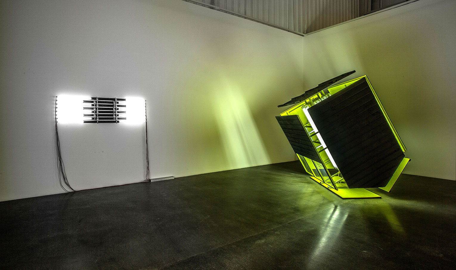 <b>Title: </b>Black Shed Expanded<br /><b>Year: </b>2016<br /><b>Medium: </b>Timber shed, fluorescent lights and fittings, bitumen, paint, steel<br /><b>Size: </b>240 x 240 x 240 cm