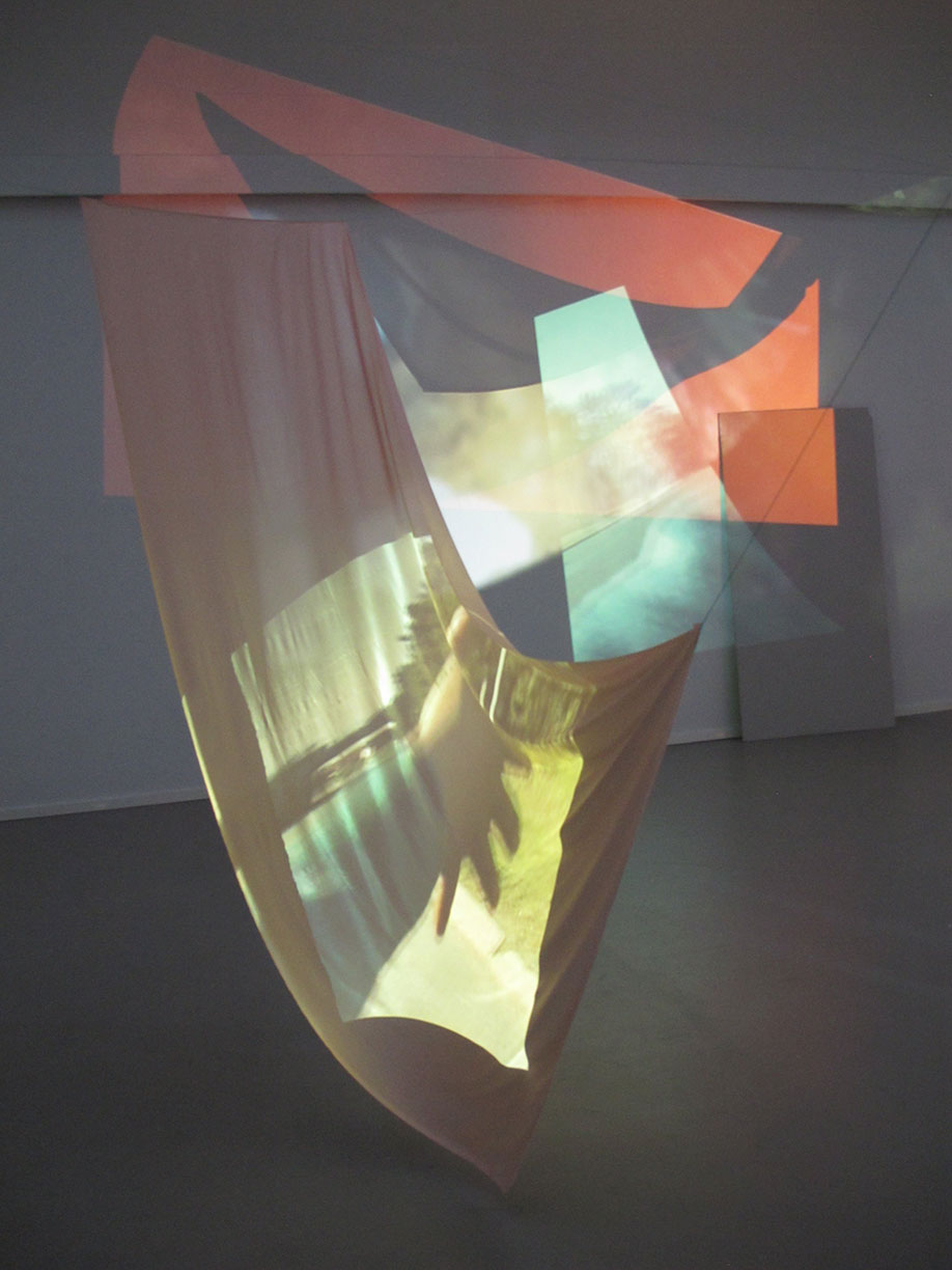 <b>Title:</b>Milk<br /><b>Year:</b>2014<br /><b>Medium:</b>Three channel HD video, sound, silk string, found objects<br /><b>Size:</b>Dimensions variable