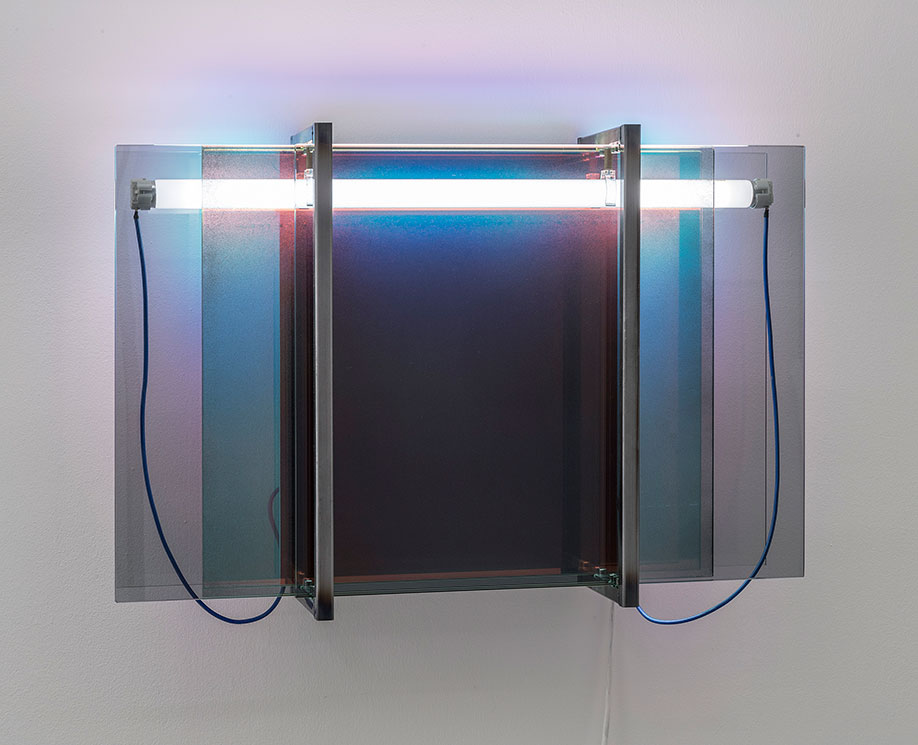 <b>Title: </b>FG03<br /><b>Year: </b>2017<br /><b>Medium: </b>Fluorescent light, smoked glass, dichroic glass, steel, spray paint<br /><b>Size: </b>64 x 43 x 19 cm