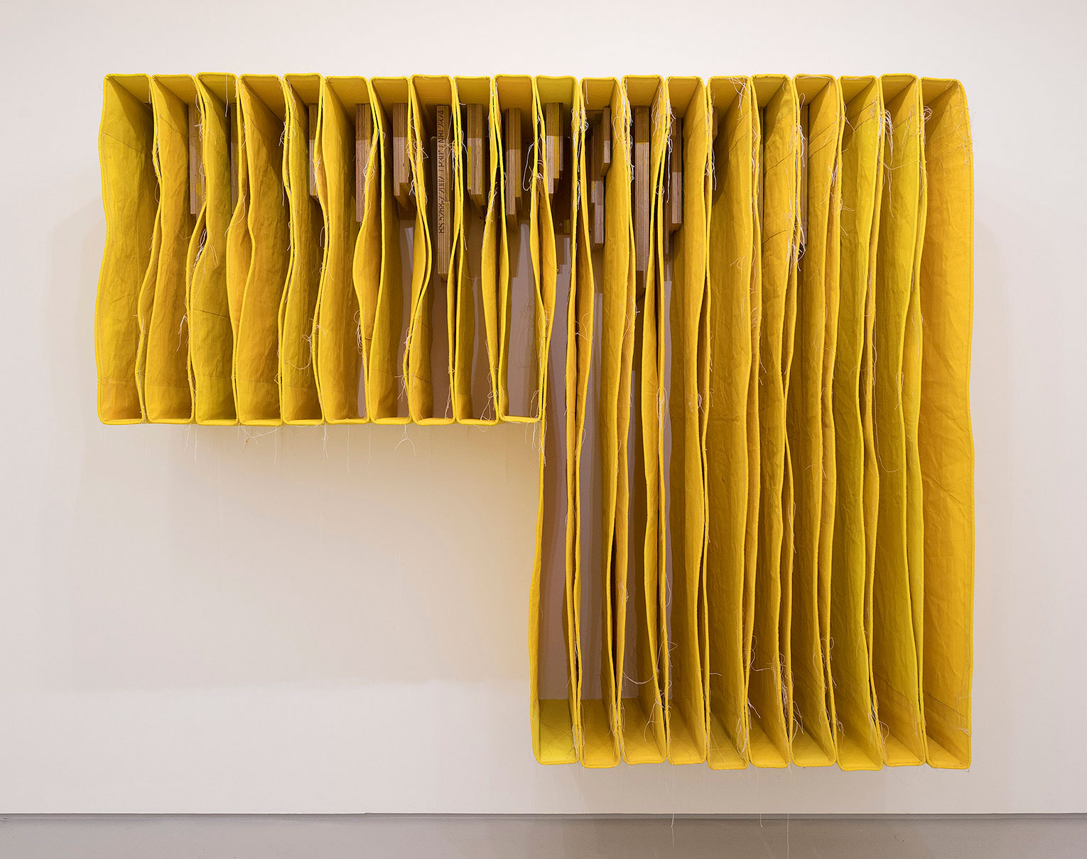 <b>Title: </b>Undercut Yellow Wallspine<br /><b>Year: </b>2017<br /><b>Medium: </b>Canvas, distemper, thread and pencil<br /><b>Size: </b>200 x 250 x 56 cm