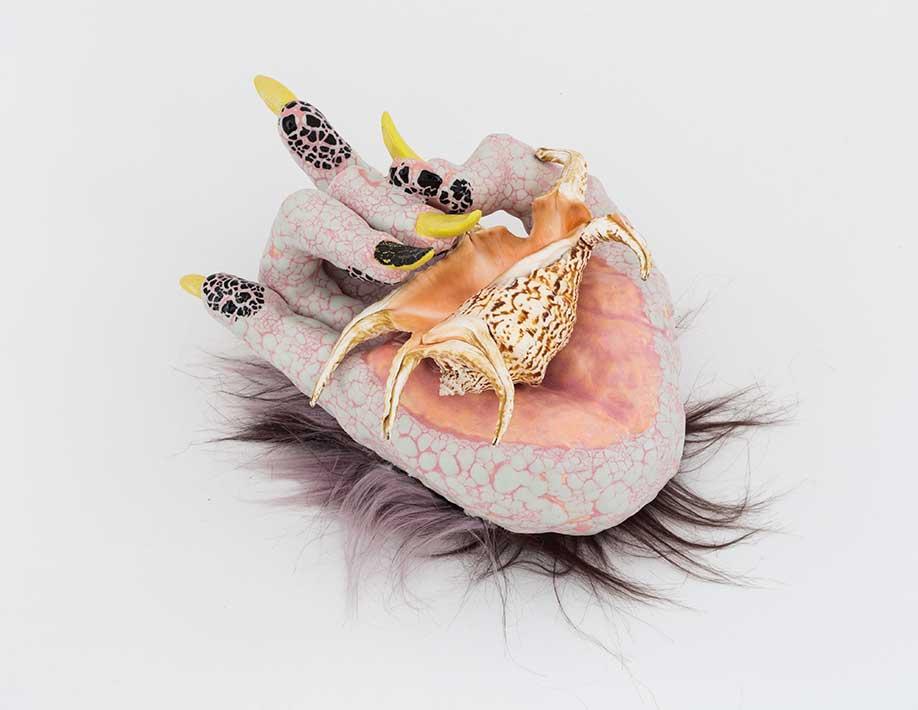 <b>Title:</b>Metal Goddess<br /><b>Medium:</b>Ceramic, faux fur, glaze, lace, shell<br /><b>Size:</b>12 x 6 x 8 inches