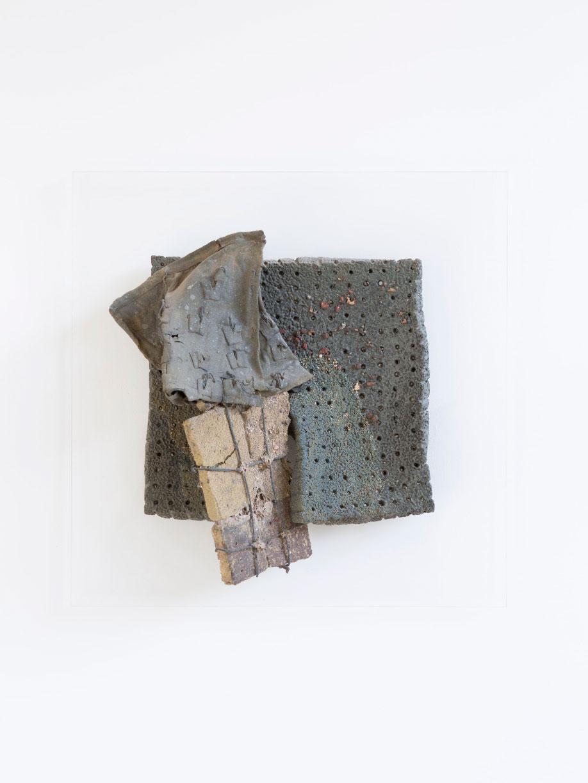 <b>Title:</b>Brick Bag<br /><b>Year:</b>1981<br /><b>Medium:</b>Melted brick in fibre glass bag, wire and clay<br /><b>Size:</b>46 x 46 cm