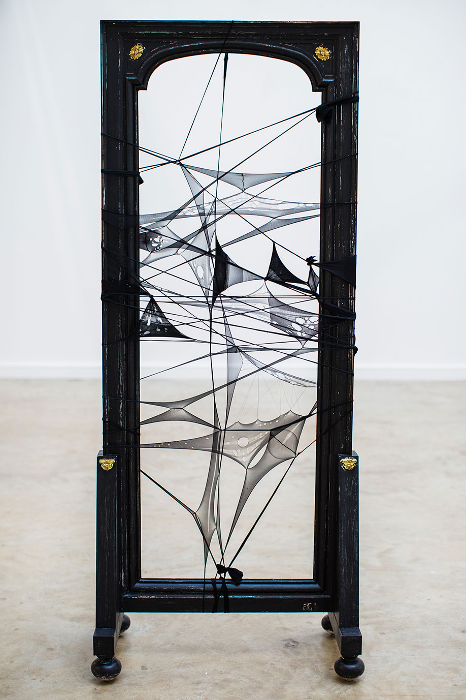 <b>Title:</b>In the Wake of Barely Black<br /><b>Year:</b>2019<br /><b>Medium:</b>Used nylon tights, cotton thread and eco-friendly water based acrylic paint on vintage chevalier shop mirror<br /><b>Size:</b>192 x 78 x 40cm