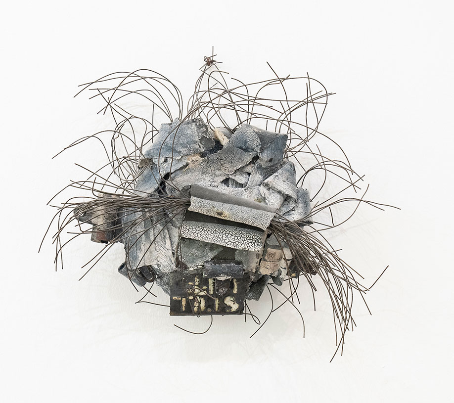 <b>Title:</b>Almost Off The Wall<br /><b>Year:</b>2001<br /><b>Medium:</b>Ceramic and electrical wire<br /><b>Size:</b>38 x 38 cm