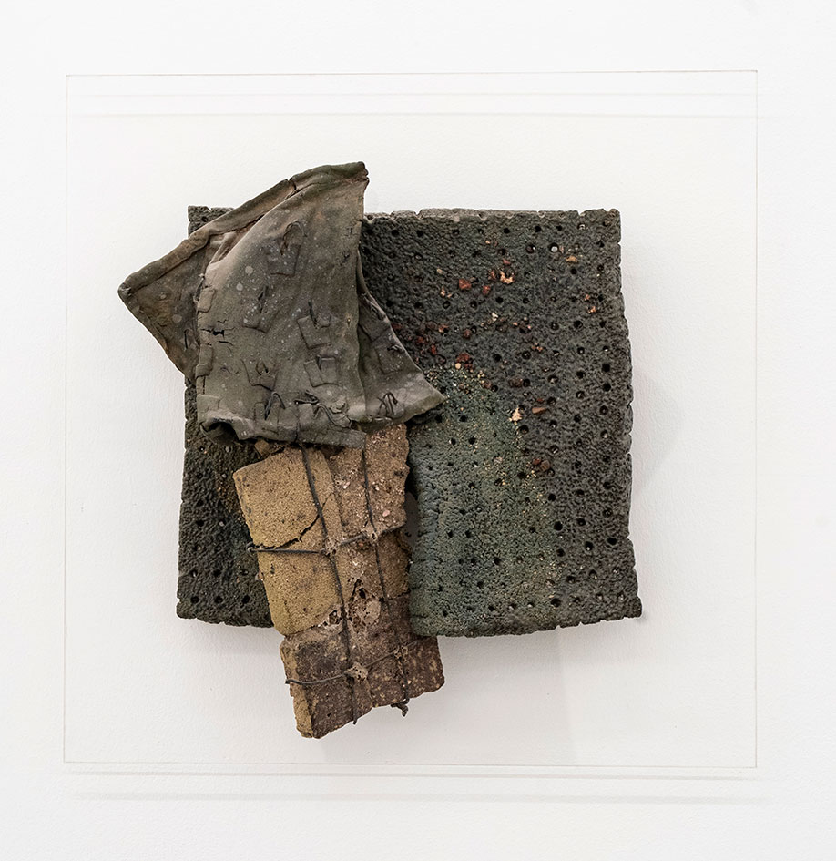 <b>Title:</b>Brick Bag<br /><b>Year:</b>1981<br /><b>Medium:</b>Melted brick in  bre glass bag, wire and clay<br /><b>Size:</b>46 x 46 cm