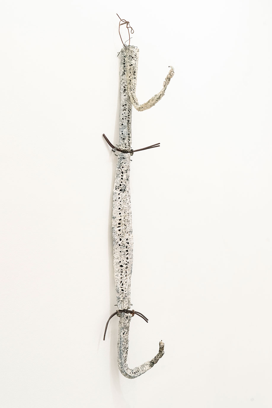 <b>Title:</b>Hook Figure<br /><b>Year:</b>1991<br /><b>Medium:</b>Sliced loofahs, cones, ceramic, shards, salvage electrical wire and metal cage<br /><b>Size:</b>141 cm