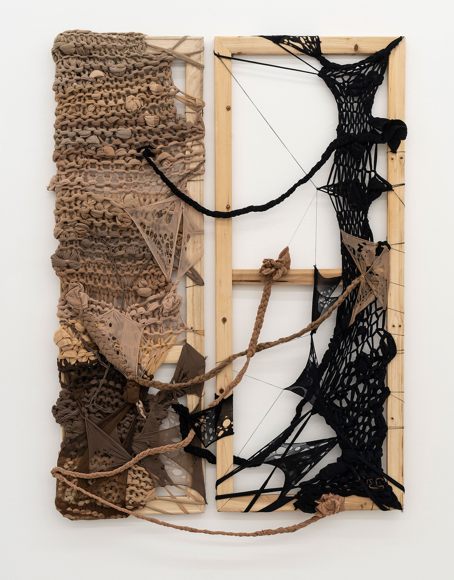<b>Title:</b>Colonialist Ravelry, An Infection Of Mind, Skin And Being. Blackness Hangs On, A Determined Survival!<br /><b>Year:</b>2021<br /><b>Medium:</b>Used tights, cotton thread and wool yarn on reused empty canvas frame<br /><b>Size:</b>100 x 73 cm